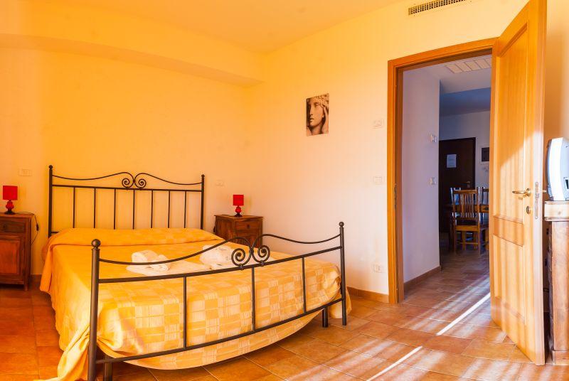 sypialnia w apartamencie w Villaggio Le Querce