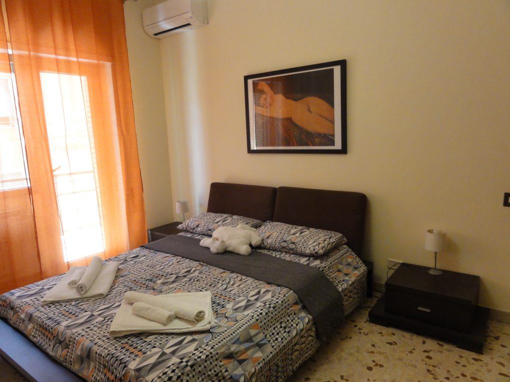 Sypialnia w apartamencie Monteverde w Rzymie